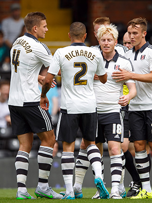Ben Pringle of Fulham celebrates scoring a goal after making it 1-0