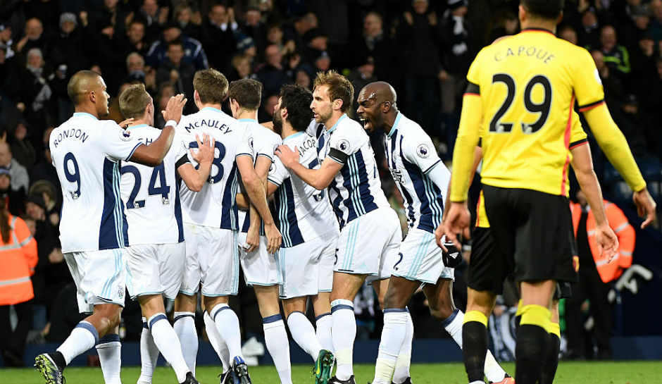 Jonny-Evans-C-of-West-Bromwich-Albion-celebrates-scoring-the-opening-goal-with-his-team-mates-during-the-Premier-League-match-between-West-Bromwich-Albion-and-Watford