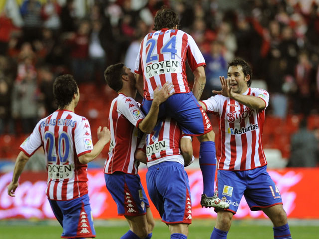 Sporting Gijon's players celebrate their
