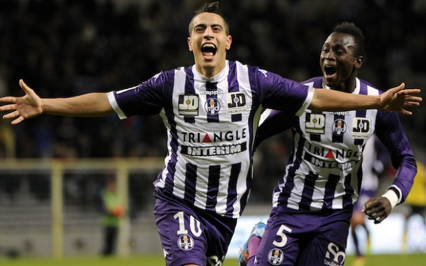 Toulouse's French forward Wissam Ben Yedder celebrates after scoring a goal during a French L1 football match between Toulouse and Sochaux on November 30, 2013 at the Municipal Stadium in Toulouse. AFP PHOTO / PASCAL PAVANI (Photo credit should read PASCAL PAVANI/AFP/Getty Images)
